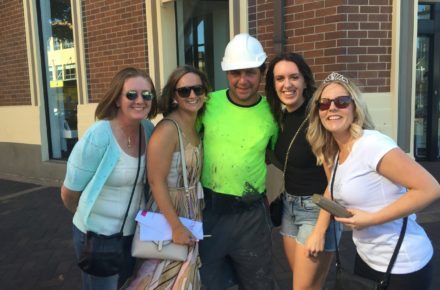 Newcastle hens fun - a team with a random construction worker.