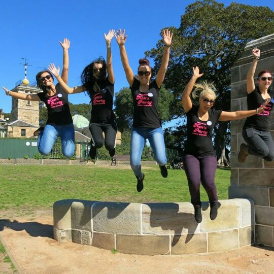 Hens party Sydney jumping for joy on a Hens Treasure Hunt in The Rocks